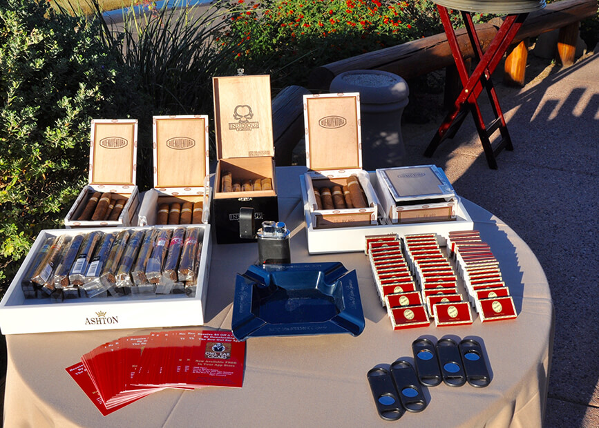 a table with boxes of cigars and accessories