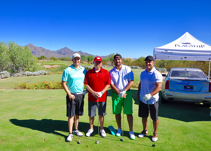 golf team membes pose on the course