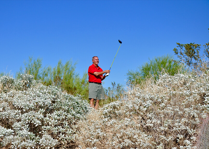 a golfer amid native brush in Arizona