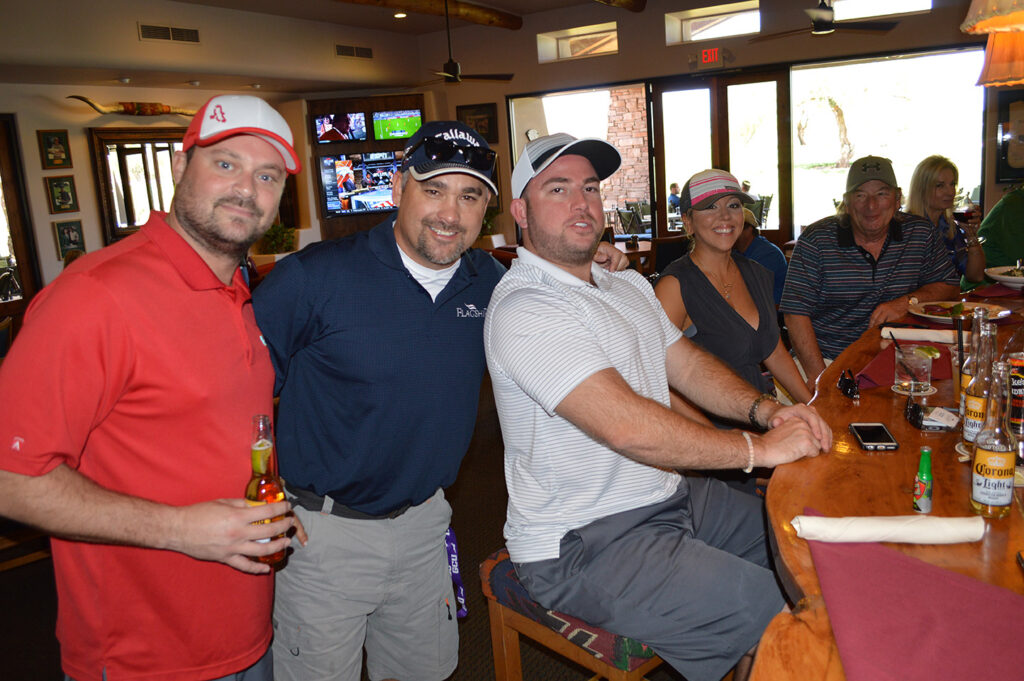 golf team members celebrate in the clubhouse