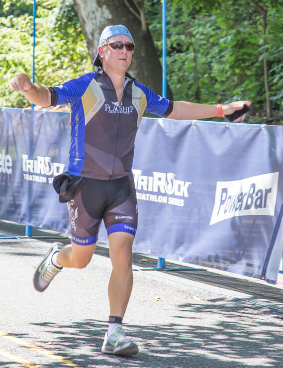 Jeff Haymore, arms outstretched, approaches the finish line