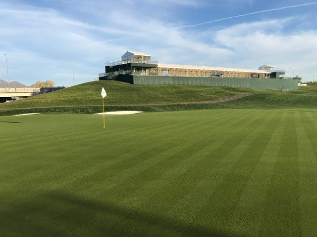a freshly-trimmed golf green